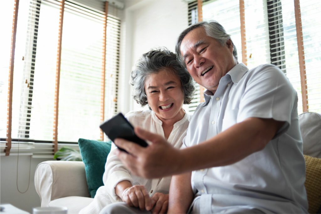 senior couple looking at smartphone