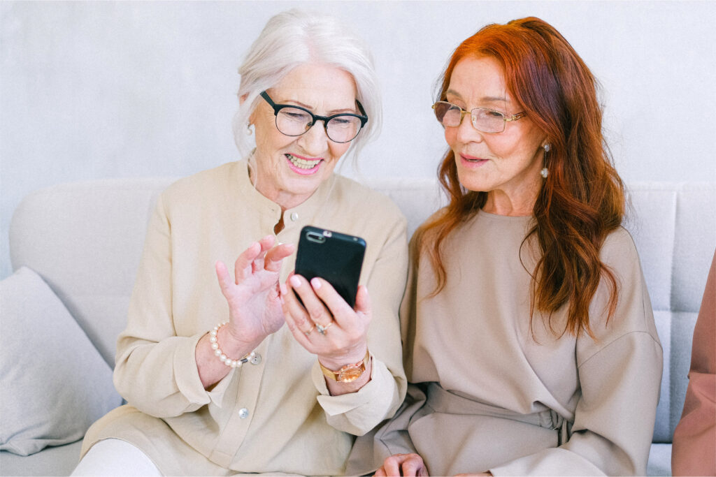 ladies interacting with smart social on phones