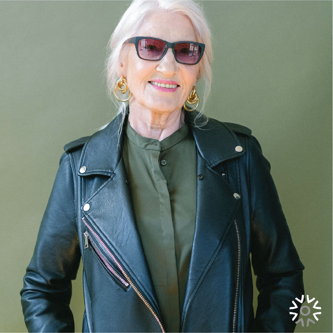 SEnior woman with sunglasses wearing a leather jacket